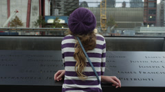 MS Rear view of girl leaning on edge of September 11 2001 memorial / Manhattan, Stock Footage