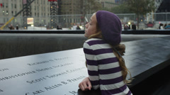 MS Girl leaning on September 11 2001 memorial / Manhattan, New York City, New Stock Footage