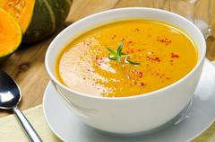Squash soup with rosemary and paprika Stock Photos
