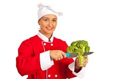 Chef cutting broccoli - stock photo