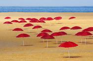 Red umbrellas Stock Photos