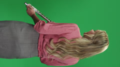 Flutist in front of a green screen Stock Footage