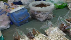 Pollen granules and enoki mushroom sold in a market, Chiangmai, Thailand Stock Footage