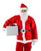 Young Santa Claus with gift box - stock photo