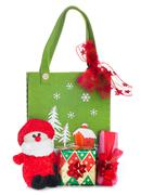 Cloth bag with Christmas decorations and gifts boxes Stock Photos