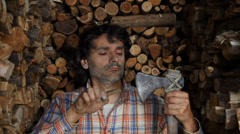 wood cutter sharpening his axe - stock footage