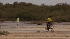 Boy falls from a bicycle, Nabq, Sinai desert Stock Footage