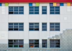Colorful Generic Wall and Windows with Square Shapes, Stones and Stock Photos