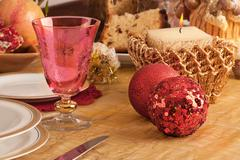 Detail of a glass of Murano in a Christmas table Stock Photos