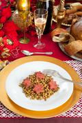 Pig trotter star shaped with lentils over christmas table Stock Photos