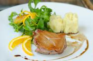 Stock Photo of Roasted duck breast with salad