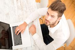 Young man with a laptop computer. Stock Photos