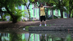 Athletic asian woman stretching in the green nature Stock Footage