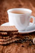 cup of fresh herbal tea and some cookies - stock photo