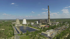 Over Thermal power plant in  wood .Aerial Stock Footage