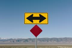 Directional arrow sign along rural road near orvada. Stock Photos