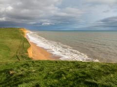coast and cliffs at west bay dorset in uk - stock photo
