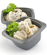 Meat pelmeni with sour cream and greens - stock photo