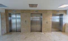 Modern elevators with closed doors Stock Photos