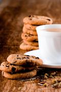 cup of herbal tea and some fresh cookies - stock photo