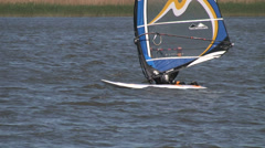 Windsurfers who start on the water - stock footage