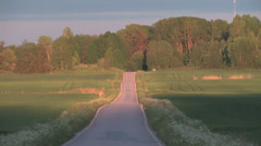 A tarmac road in the evening sun Stock Footage