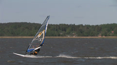 Quick Windsurfers on the water Stock Footage