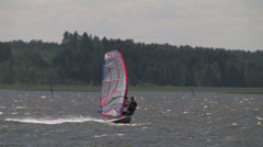 Quick Windsurfers on the windy waters - stock footage