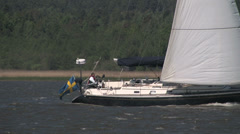 A sailboat with two people in Stock Footage