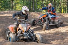 Men drive motocross track Stock Photos