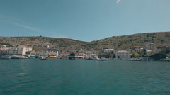 View Balaklava with a yacht that comes into the bay Stock Footage