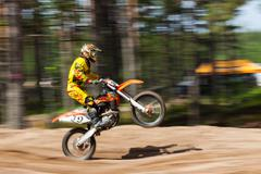 A competitor jumps motocross track Stock Photos