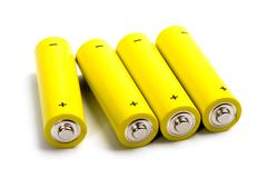 four yellow alkaline batteries - stock photo