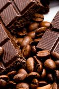 Coffee beans and black chocolate Stock Photos