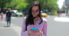Young Latina Hispanic woman in city walking texting smart phone cellphone Stock Footage