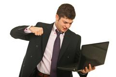 Nervous business man fist  laptop Stock Photos
