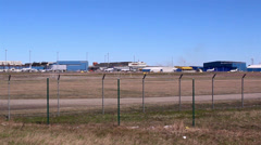 Airplanes on standby at the airport Stock Footage