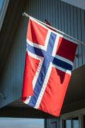 white house with flag in old part of stavanger, norway - stock photo