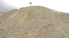 A yellow sign on top of the hill of limestone Stock Footage