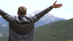 Young man enjoying nature outdoor. Stock full HD video footage 1080p Stock Footage