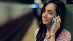 Young Latina Hispanic woman in city talking cellphone subway - stock footage