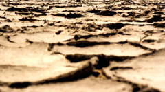 Cracked dry earth. Global warming concept. Full HD 1920x1080p. Slow-mo Stock Footage