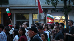 Protesters Pass On The Street - pan Stock Footage