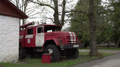 An old red truck on standby Stock Footage