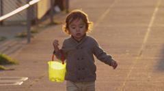 USA, California, San Francisco, Alamo Square Park, Boy (2-3) holding plastic Stock Footage