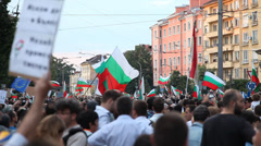 Protesters brandishing flags in the square Stock Footage
