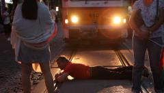 Man Lying On The Rails  Blocks The Tram At The Time Of Protest March In Sofia Stock Footage