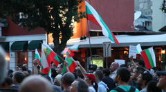 People waving Bulgarian flags during anti government protests in Sofia  Stock Footage