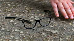 Man looking for fallen eyeglasses Stock Footage