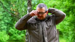 Man suffering from eye strain Stock Footage
